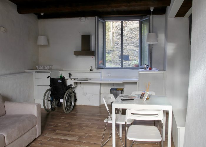 In the kitchen/living room an accessible table is located with chairs, a double sofa bed and a television of course.