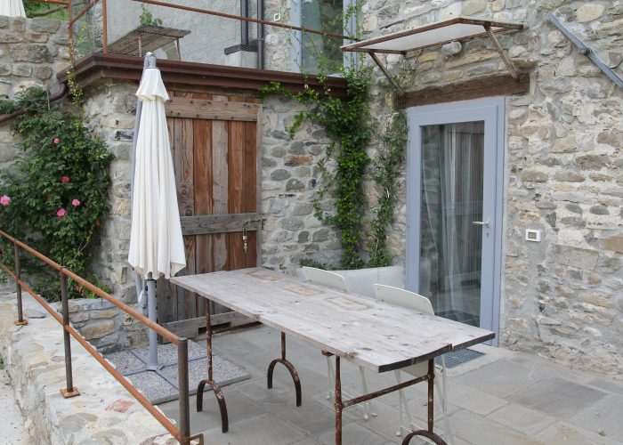 "With this pictures the ""Casa di Sotto"" tour starts, with the terrace and the entrance door. From the terrace you reach the staff dedicated area."